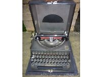 ANTIQUE PORTABLE TYPEWRITER, IMPERIAL THE GOOD COMPANION. IN WORKING ORDER WITH CARRY CASE.