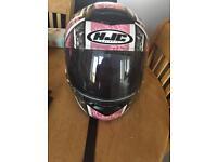 Pink motorbike helmet