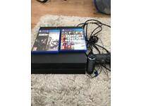 PlayStation 4 500GB and 2 games for sale