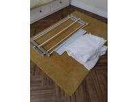 Single fabric clothes rail.