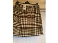 Size 12 black and white checkered short skirt brand new with tags