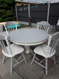 Beautiful upcycled table and 4 chairs painted in grey and white.