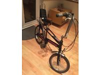 Authentic Raleigh chopper bicycle personalised with black paint and pink stickers