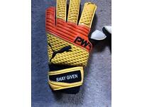 Shay givens signed football gloves worn by him
