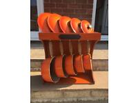 Le creuset 5 pan set in volcanic orange & wooden display rack.
