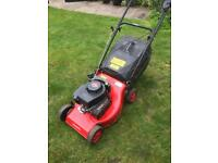 Rotary petrol lawnmower