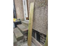 2 x 2.10m round fence posts £10 the pair