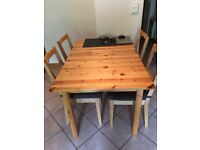 Solid extendable pine table and 4 chairs