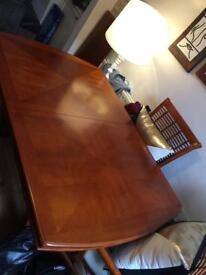 GONE, SORRY! Wooden extendable dining room table and chairs