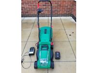 Qualcast cordless lawn mower and electric scarifier.