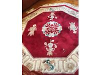 Octagonal rug red & cream with a touch of turquoise