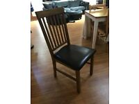 Marks and Spencer's wood and brown leather chair