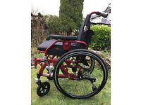 Full suspension red wheelchair