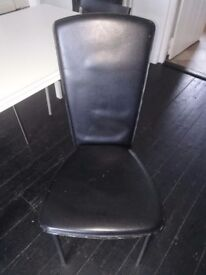 Two black leather-look chairs
