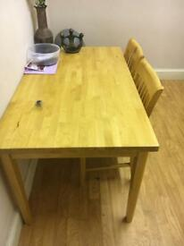 Wooden table and four matching chairs