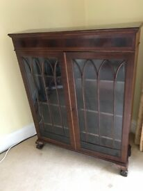 Stylish antique wooden and glass book case