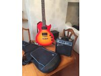 Epiphone Les Paul Special II guitar in cherry burst c/w squire 10w amp and POD gig bag.