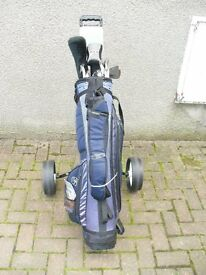 SET OF 12 GOLF CLUBS, BAG, TROLLEY, BALLS, TEES, WILSON PROSTAFF, TRANSLINE, APOLLO VENTURE - YES.