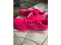 Bright pink reebok trainers