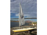 Laser sailing dinghy 113665, sunshine yellow, 3 sails, trolley and trailer. Good condition.