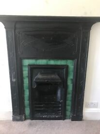 Antique Cast Iron Fireplace - fully intact with tile surround.