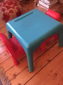 Toddlers blue table & 2 red plastic chairs for sale