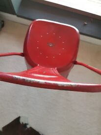 Replica Tolix chair in red.