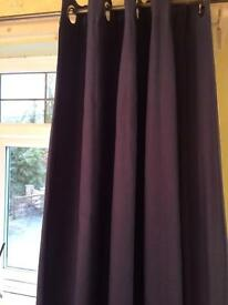 Next blue curtains with silver eyelets lined with 100% cotton blackout lining.