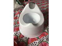 white plastic pottie