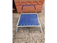 Mini trampoline with handle.