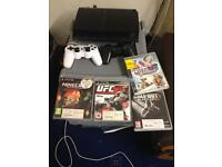 PS3 + 4 games 2 pads