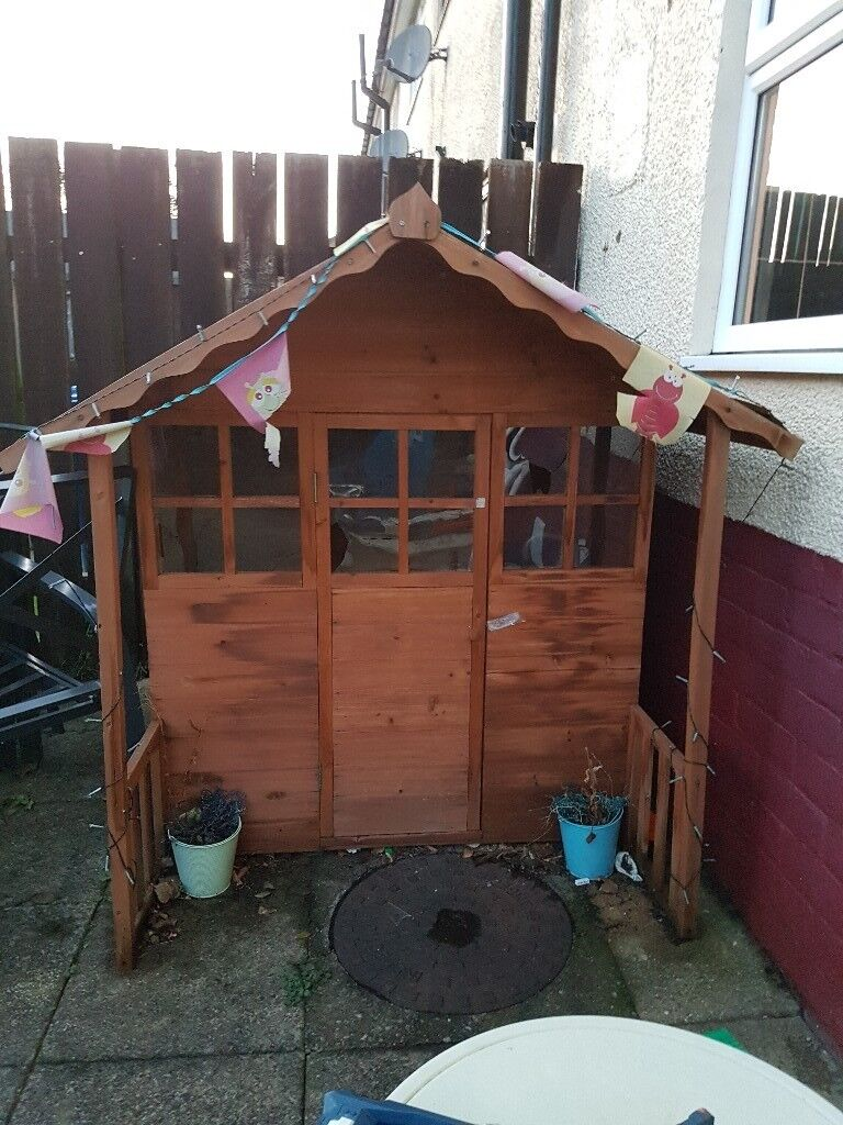 Wooden playhouse with kitchen