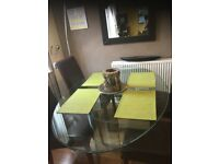 Bestoke ovol glass dining table and 4 chairs