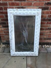 White upvc window, frosted glass, size 630 x 1040mm with handle and cill, side opening