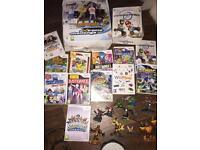 Wii bundle with family trainer, mario kart wii play,sky landers and more