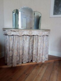 Vintage kidney shaped dressing table with glass top, mirrors, brocade curtains