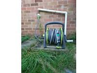 Pressure washer and garden hose