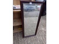 Mirror. Tall dark wood