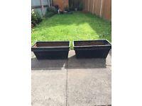 Two black long pots