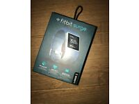 BRAND NEW NEVER BEEN USED blue Fitbit Surge (Large)