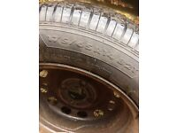 "Four part worn tyres and 15"" wheel rims"