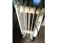 Little oil filled electric radiator heater very good condition will need a clean from storage