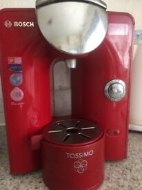 Red Bosch Tassimo with 13 pods and holder