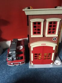 Fisher price fire station and engine