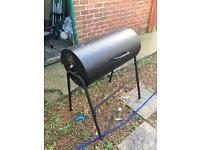 Large barrel barbecue.