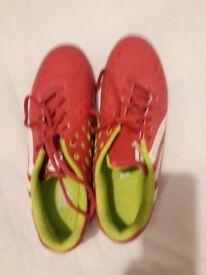 Bright pink mens football boots