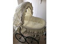 Old fashioned cart style moses basket