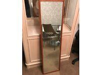 Long Mirror with dark oak wood.