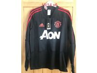 Brand new man united shirt age 13/14
