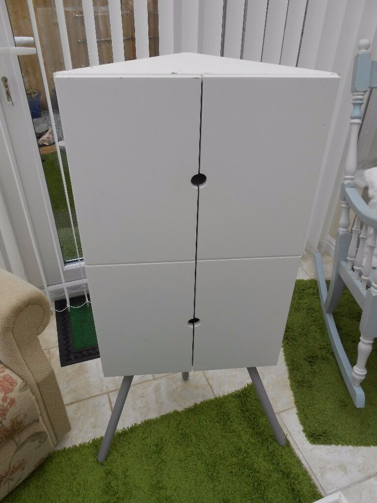 IKEA white TRIANGULAR CORNER CUPBOARD,shelves inside,metal legs ...